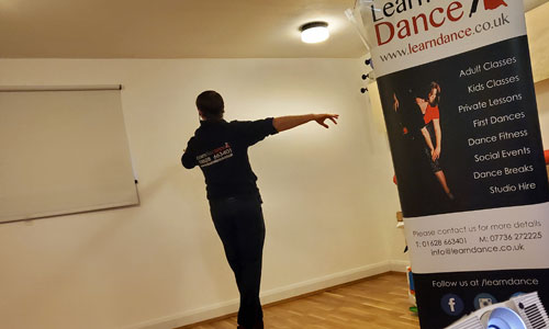 A picture showing our instructor Antony providing a zoom dance lesson and youtube videos recording