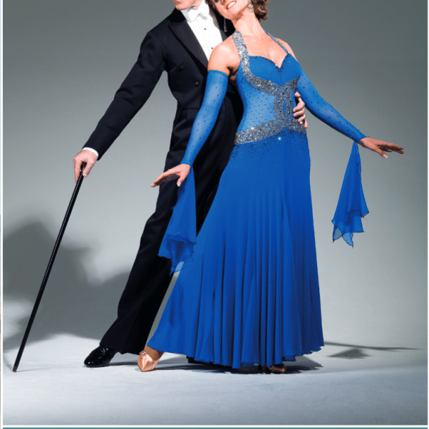 Dance Down The Danube with Anton & Erin screenshot showing Anton & Erin in tailsuit, top hat, cane and [Erin] ballgown. Below text detailing dates of trip